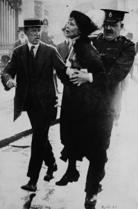 British suffragette leader Emmeline Pankhurst being arrested by police outside Buckingham Palace in 1914